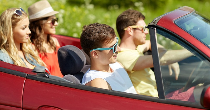 Teens Driving in Convertible Car